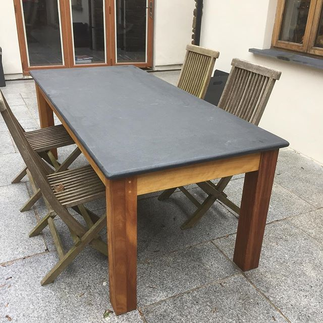 Patio Table delivered, top is 30 mm Brazilian slate, legs and apron are Iroko