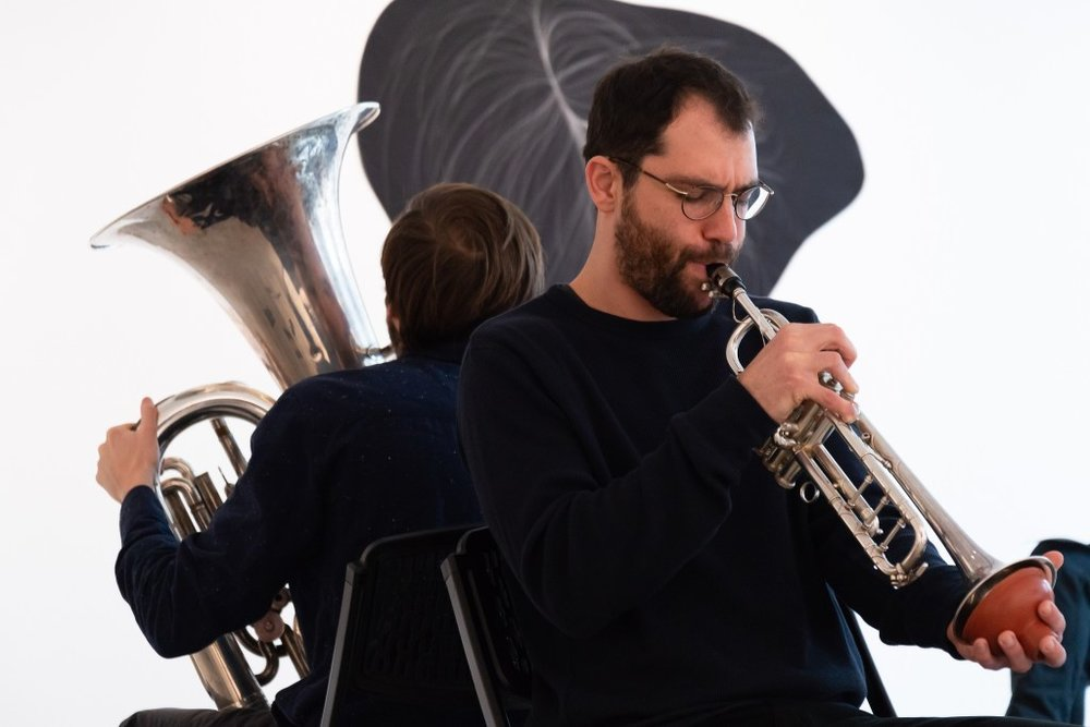 """For """"The Hanging Quilts of Measure,"""" Max Murray (tuba) and Adi Snir (sax/trumpophone) turned the artist's stitches into improvisations. Kevin Grady/Radcliffe Institute"""