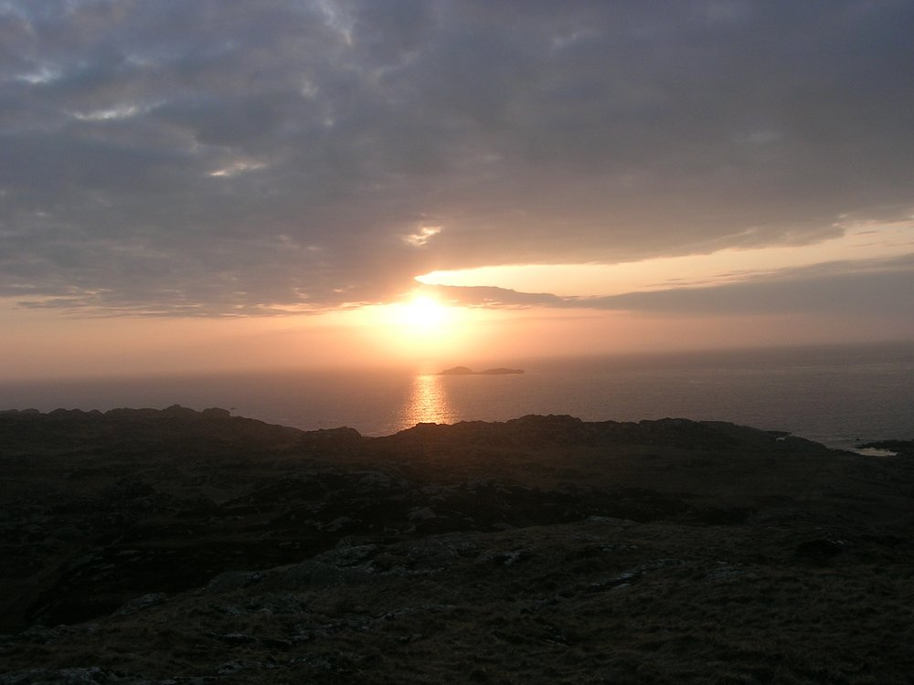 {This photo is one I took in 2007 when my husband and I traveled to Scotland. On the Isle of Iona, I climbed this hill, passing sheep along the way, and alone with the Lord, sat and watched the sunset one evening during Holy Week.}