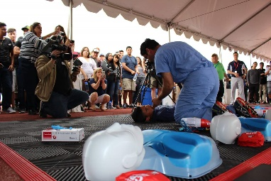 Nearly 500 students from Desert Mirage High School observe Dr. Ruiz demonstrate critical CPR and AED techniques.