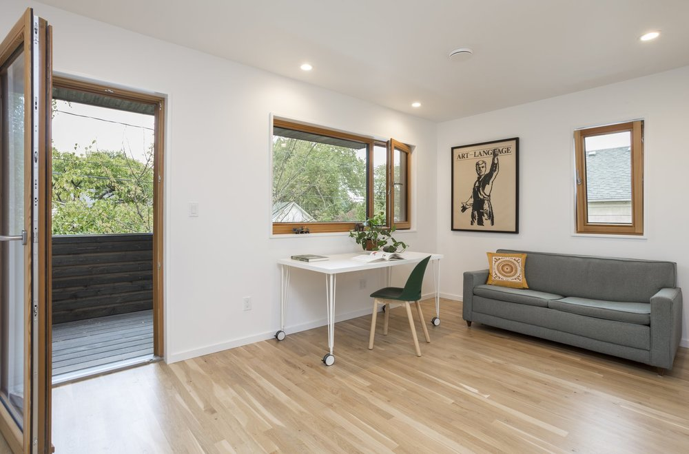 a-home-office-is-located-on-the-upper-floor-at-the-front-of-the-house-with-a-private-balcony-that-also-serves-as-the-covering-of-the-front-porch.jpg