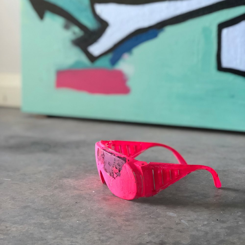 closeup of pink dirty glasses on grey concrete floor