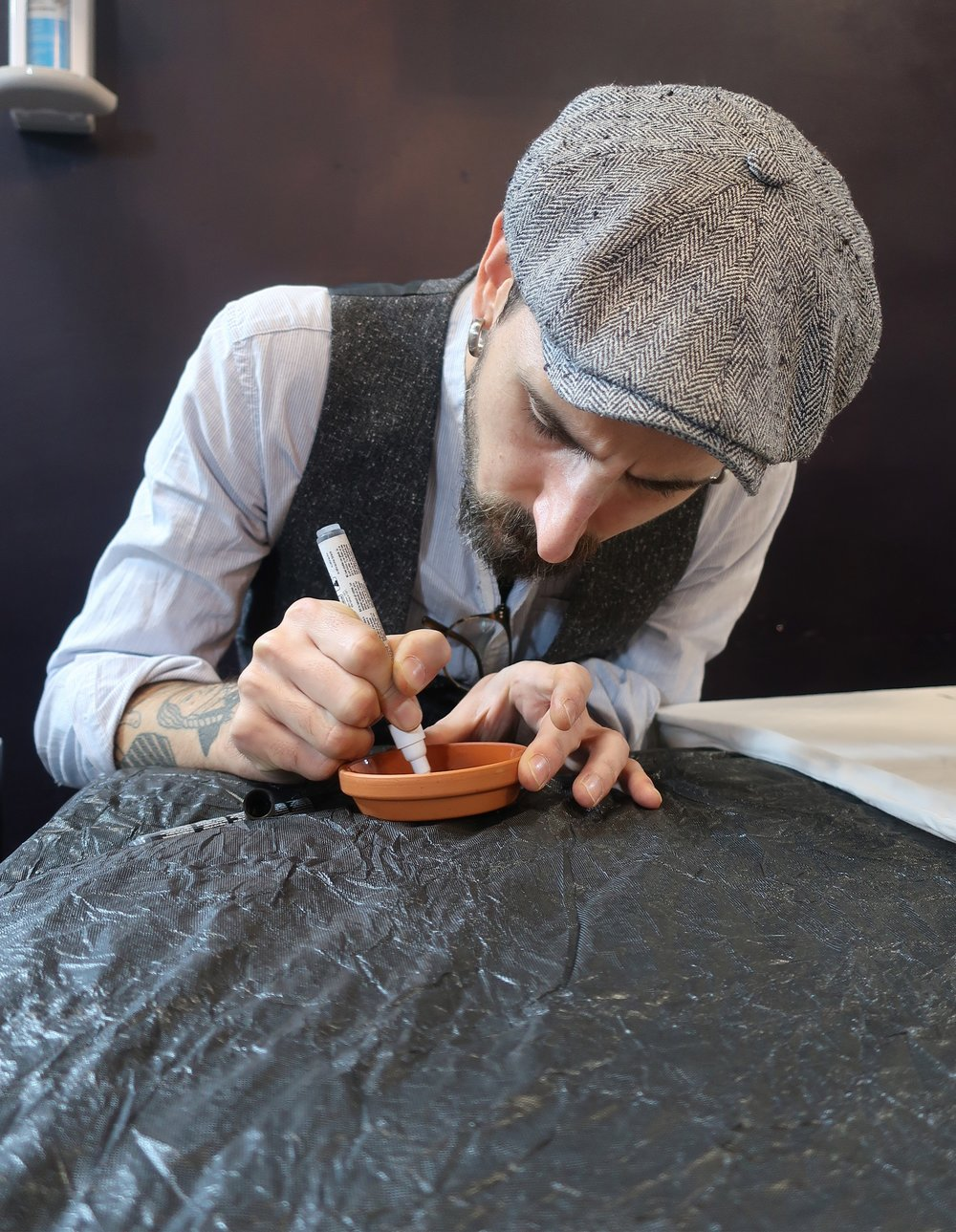 Artist Adria Deyza painting on pottery.jpeg