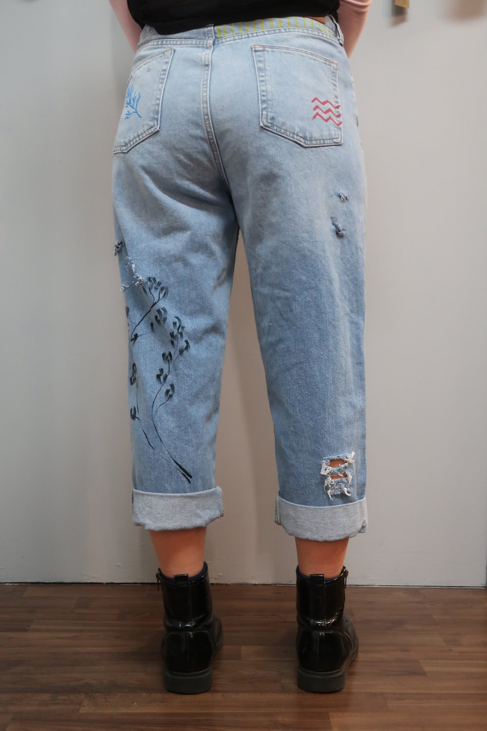 Back view of floral denim pants painted by Alba Rey and drawn on by Be tattoo.jpeg