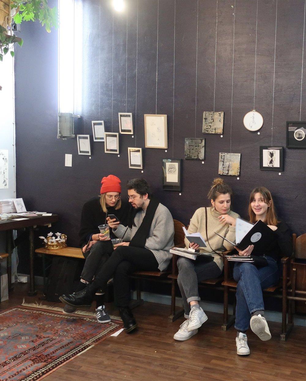 visitors checking out tattoo portfolios.jpeg