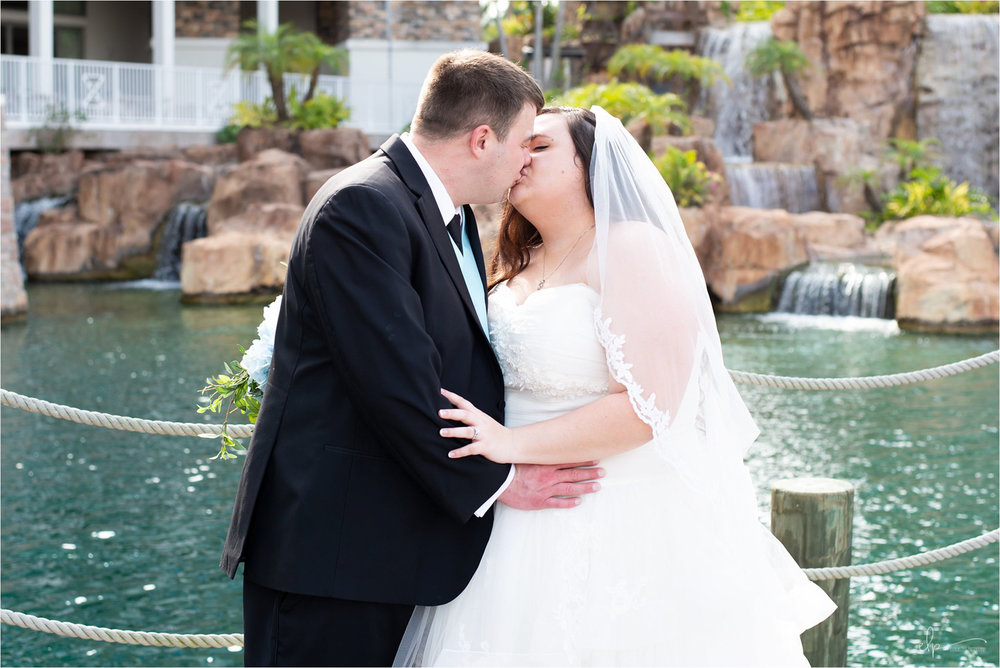 Bride and groom kiss at Sapphire Falls Resort