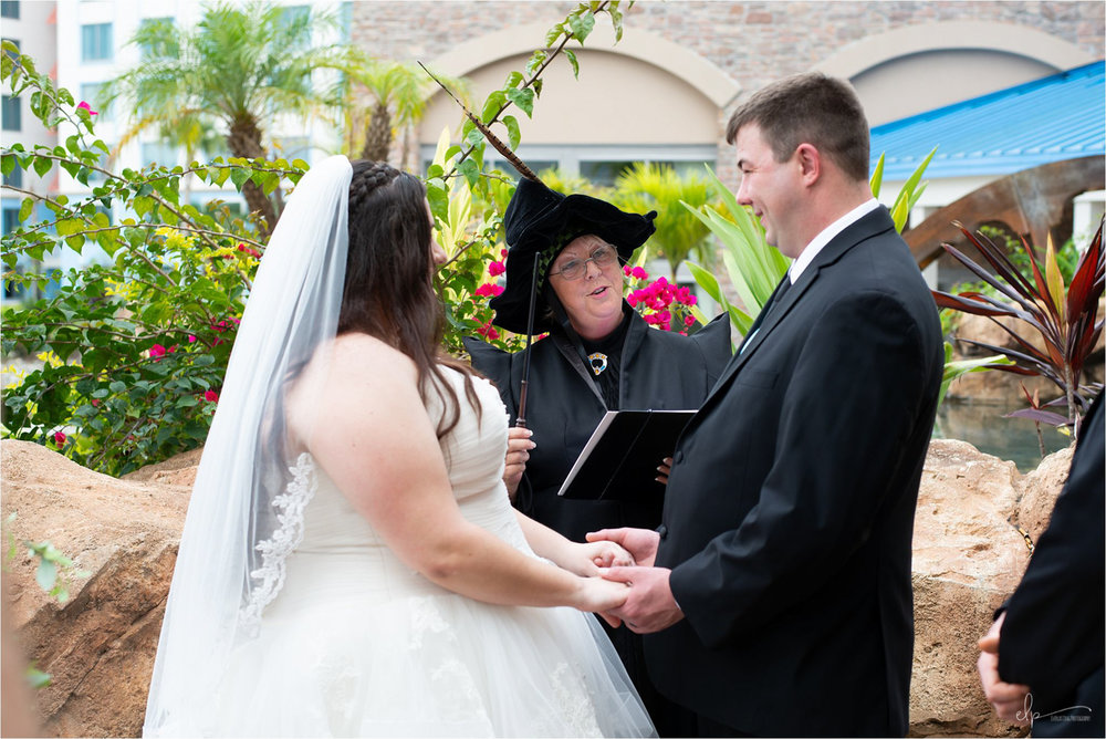 Wedding officiant pronounce husband and wife.