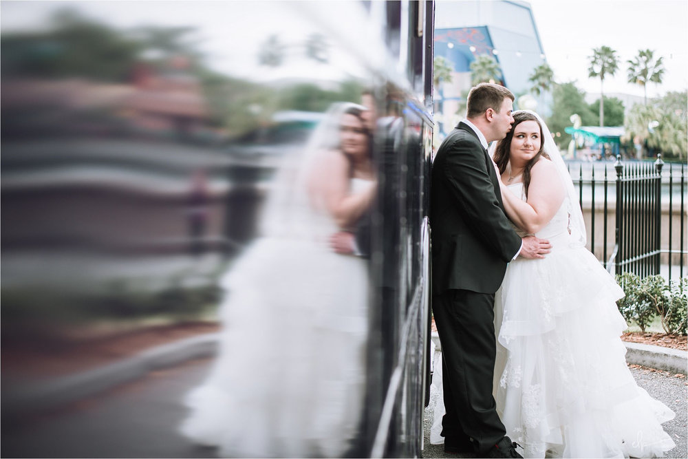 Bride and groom pose at Harry Potter Purple Bus.