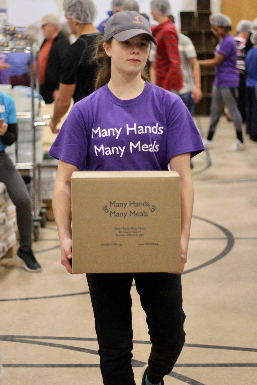 Girl carrying box.jpeg