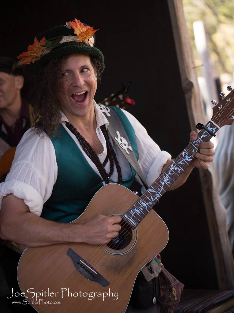 Frostylocks - New addition to our Faire for 2019!Royal Jongleur, Minstrel Of The Fae & Bard Of The People is an off-beat singer-songwriter whose story-songs highlight his wandering lane act. From illustrious anthems inspiring revelry and good cheer to comedic tales that leave listeners rolling in the lanes, this musicman entertains patrons of all ages. His improv-based style and hip-hopity happiness ensure a joyous and memorable experience to all those he serenades