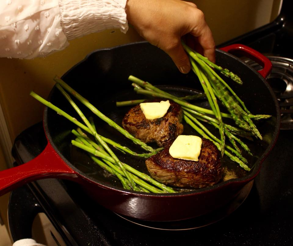 Add some butter and greenery to the skillet. I like to do asaparugus with my steaks.