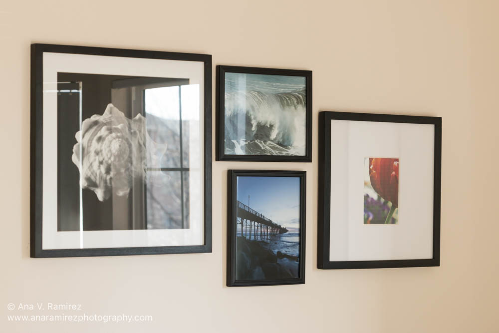 framed photos in home office