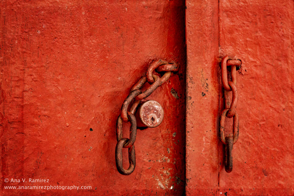 red metal door with chains