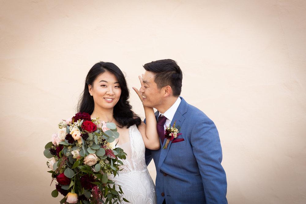 Sassy bride with groom in Napa.jpg