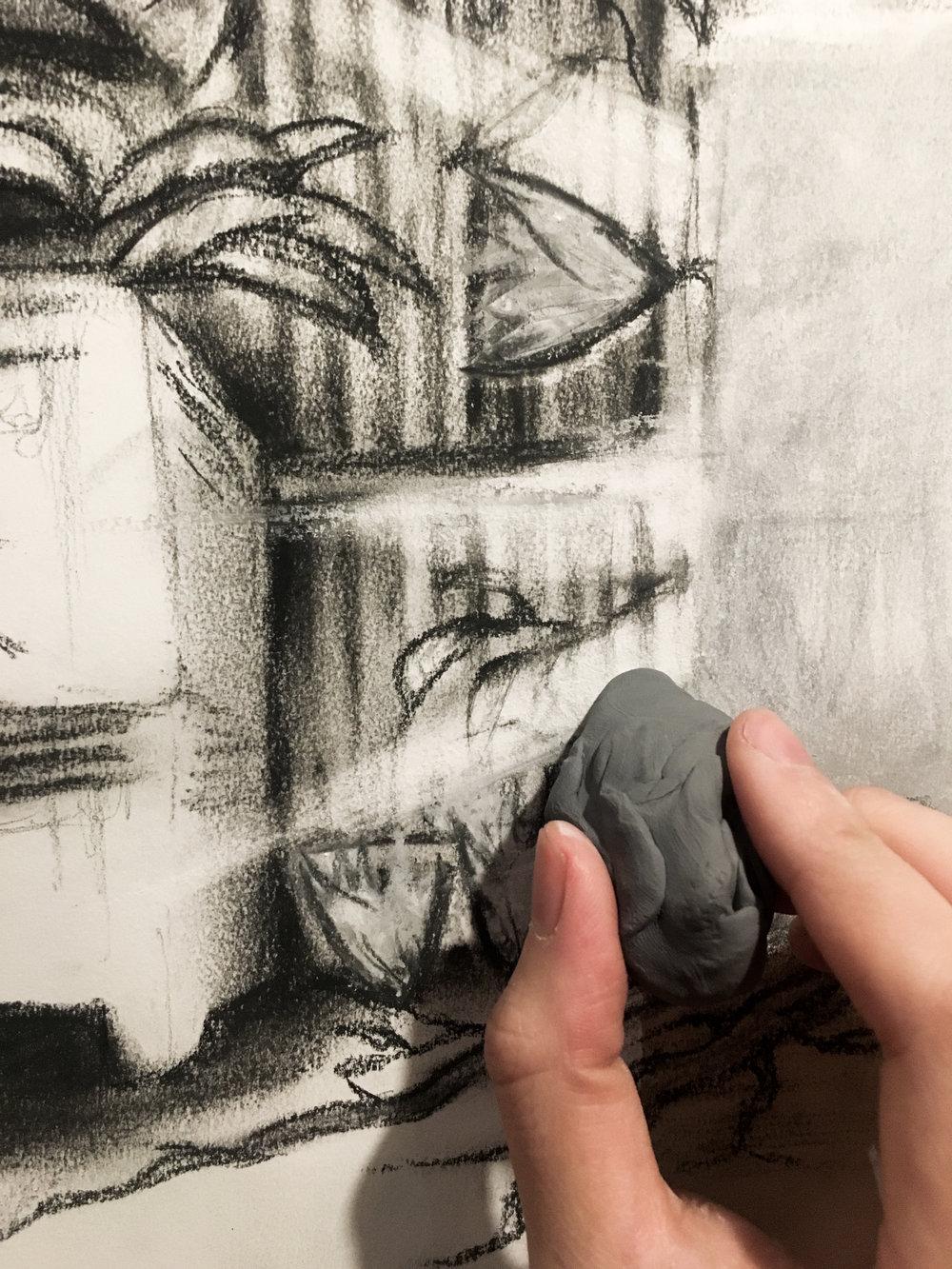 Close-up of erasure using a kneadable eraser
