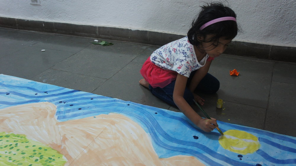 Painting a backdrop at Museum Summer Camp 2018