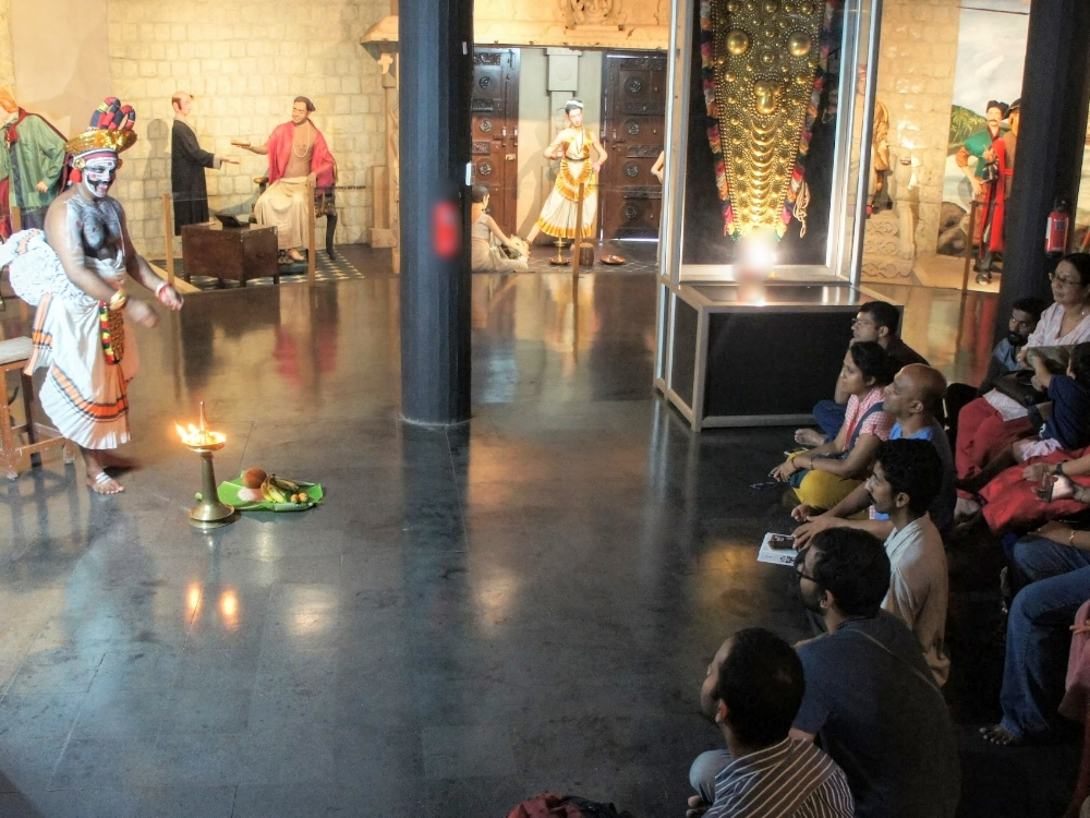 Visitors watch a Chakiar Koothu show in the History Museum