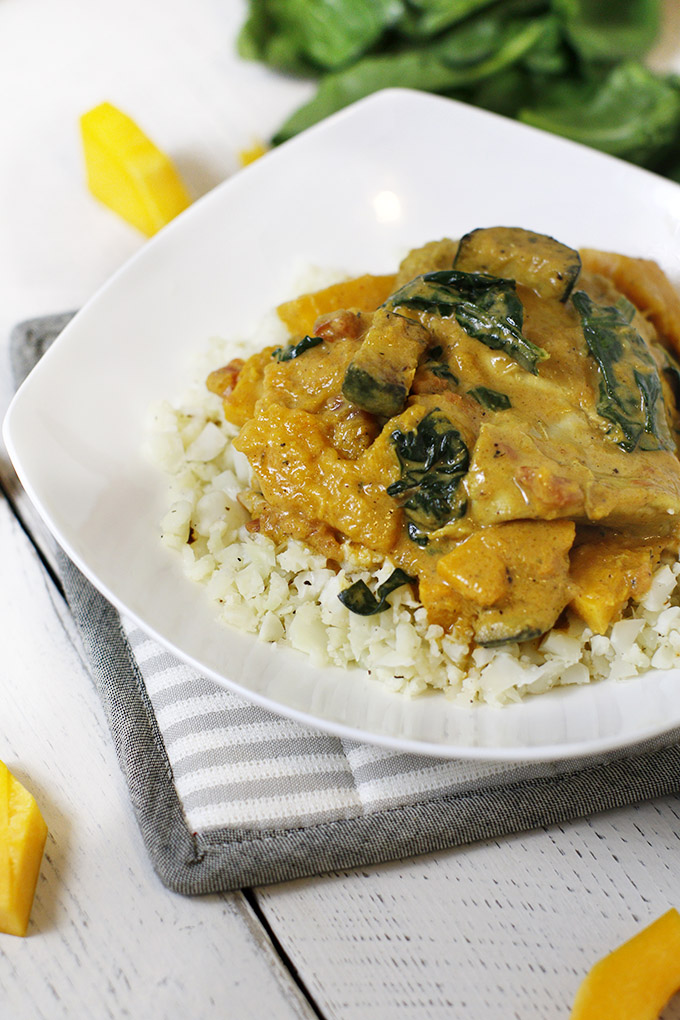 A Paleo chicken curry and cauliflower rice recipe made with roasted butternut squash and creamy, dairy-free yogurt!