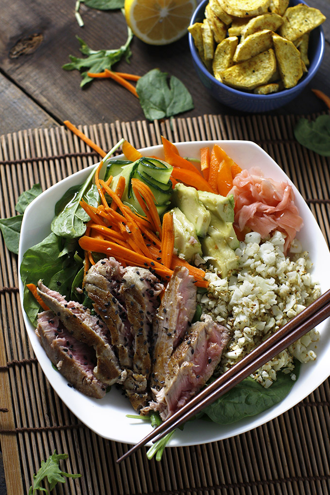 "A sushi salad topped with warm ahi tuna, cauliflower rice and veggies. Served with roasted curry sweet potato ""fries""!"