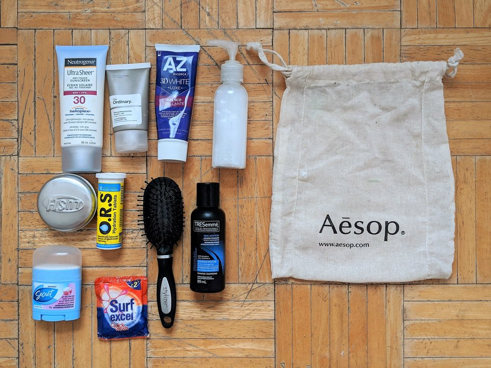 Toiletries. - Because I don't check luggage, I minimize my toiletries by only bringing minis. I always make sure to bring hydration tablets or salts (just in case!) and I love to bring solid shampoo - my favourite is from LUSH. I throw everything into a recycled linen Aesop bag from a previous purchase.