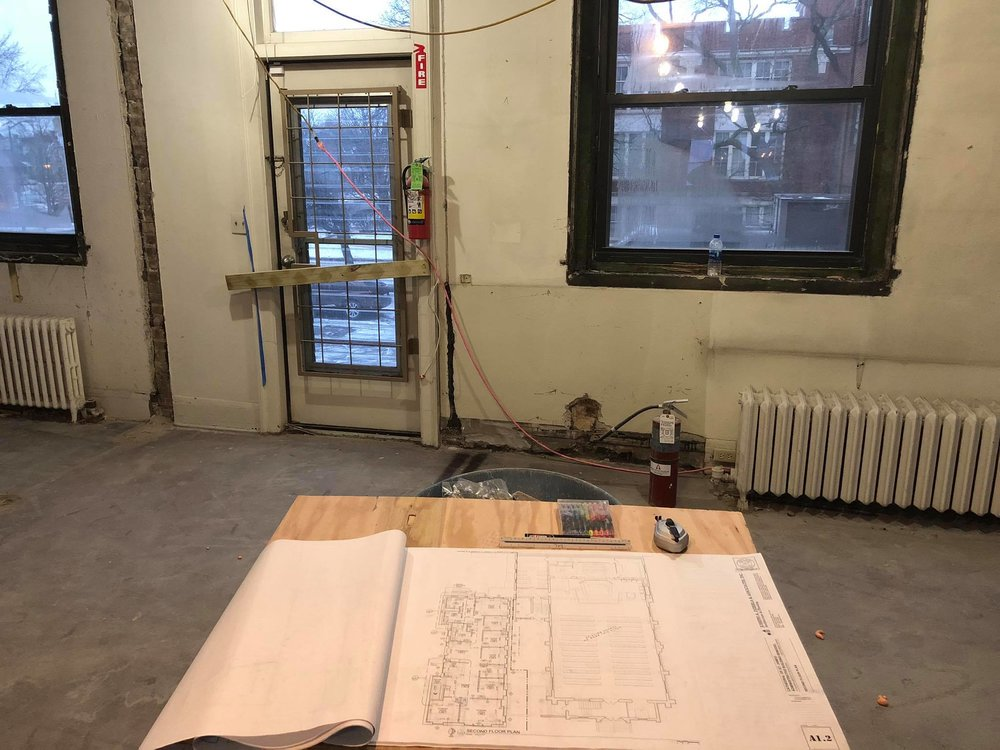 Blueprints on a table where the old conference room once stood (and new office of the Bishop will stand soon).