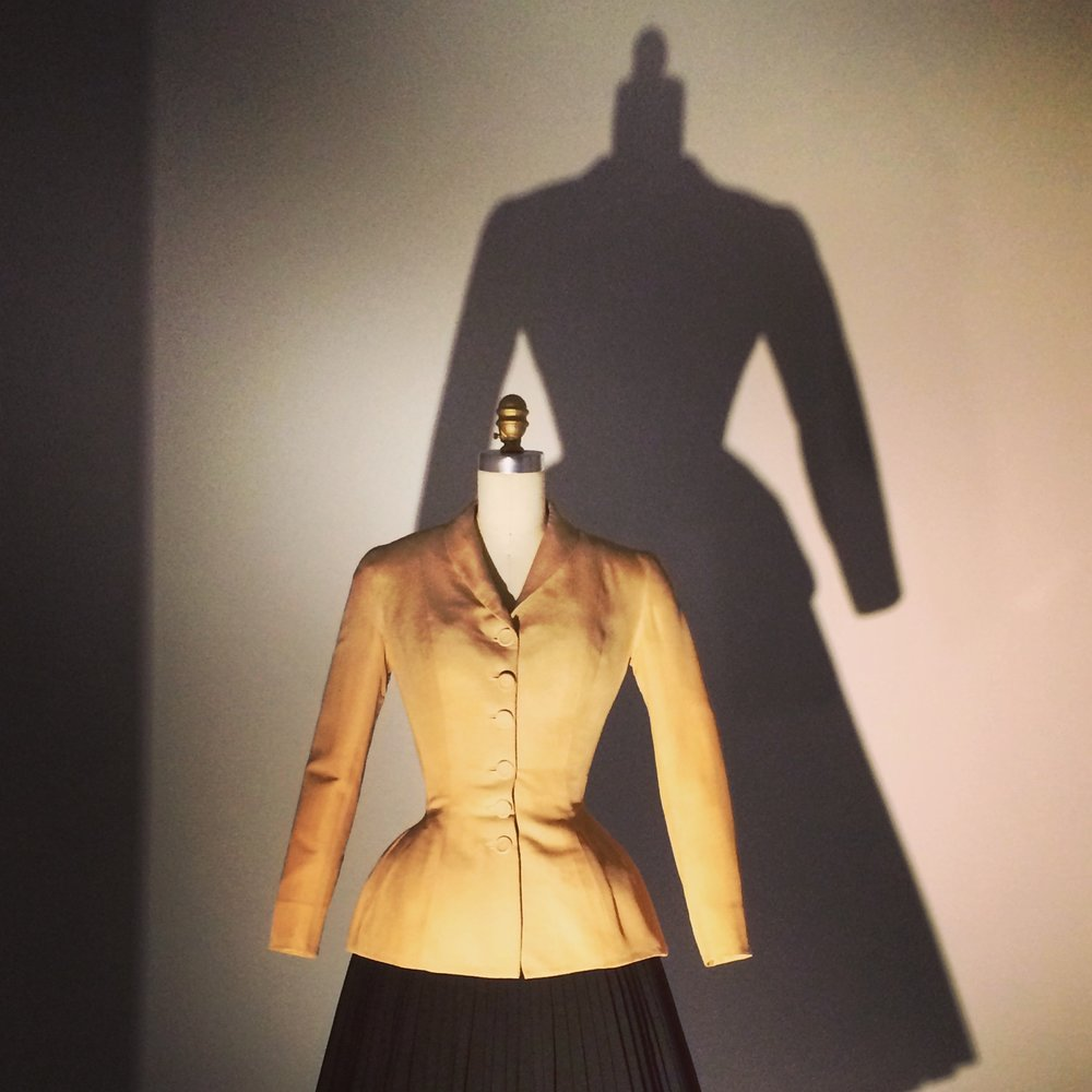 "Christian Dior's iconic ""Bar"" suit during the installation of the CI's 2016 ""Manus x Machina"" exhibition"