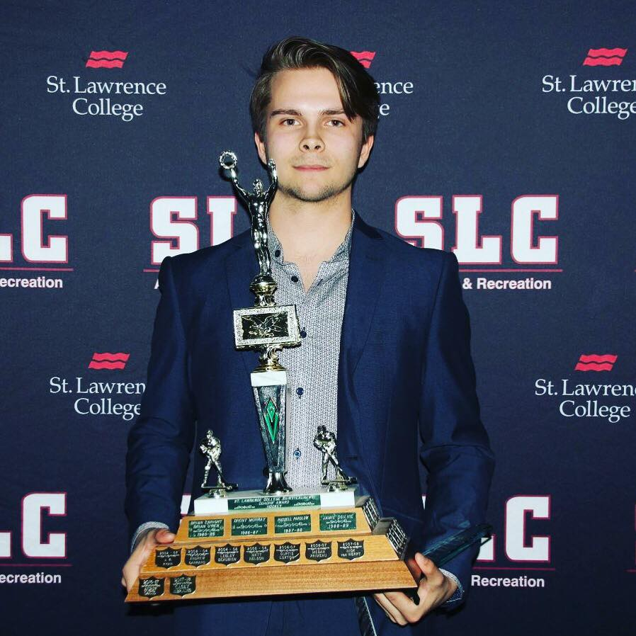 Casey receiving the Coaches Award for St. Lawrence College of the Ontario Colleges Athletic Association.