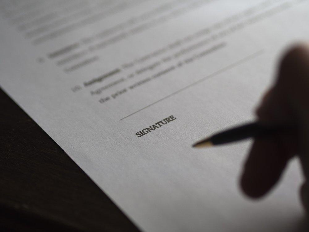 administration-agreement-blur-261625.jpg