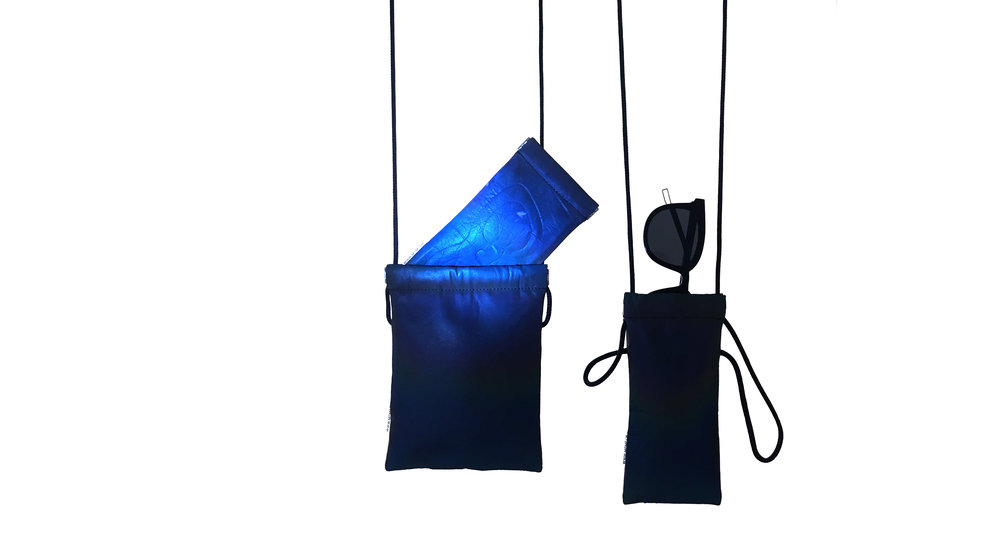 _BLACK MAGIC GLOW PURSE - .THE BLACK MAGIC GLOW PURSE IS MADE OF DARK, ALMOST BLACK COATED NEOPRENE MATERIAL. THE WATERPROOF OUTSIDE COATING HAS A FULL REFLECTIVE SURFACE WHICH SENDS BACK THE LIGHT THAT SHINES ON IT AND SHOWS AN UNREAL COLOR GLOW.CLICK FOR MORE INFO