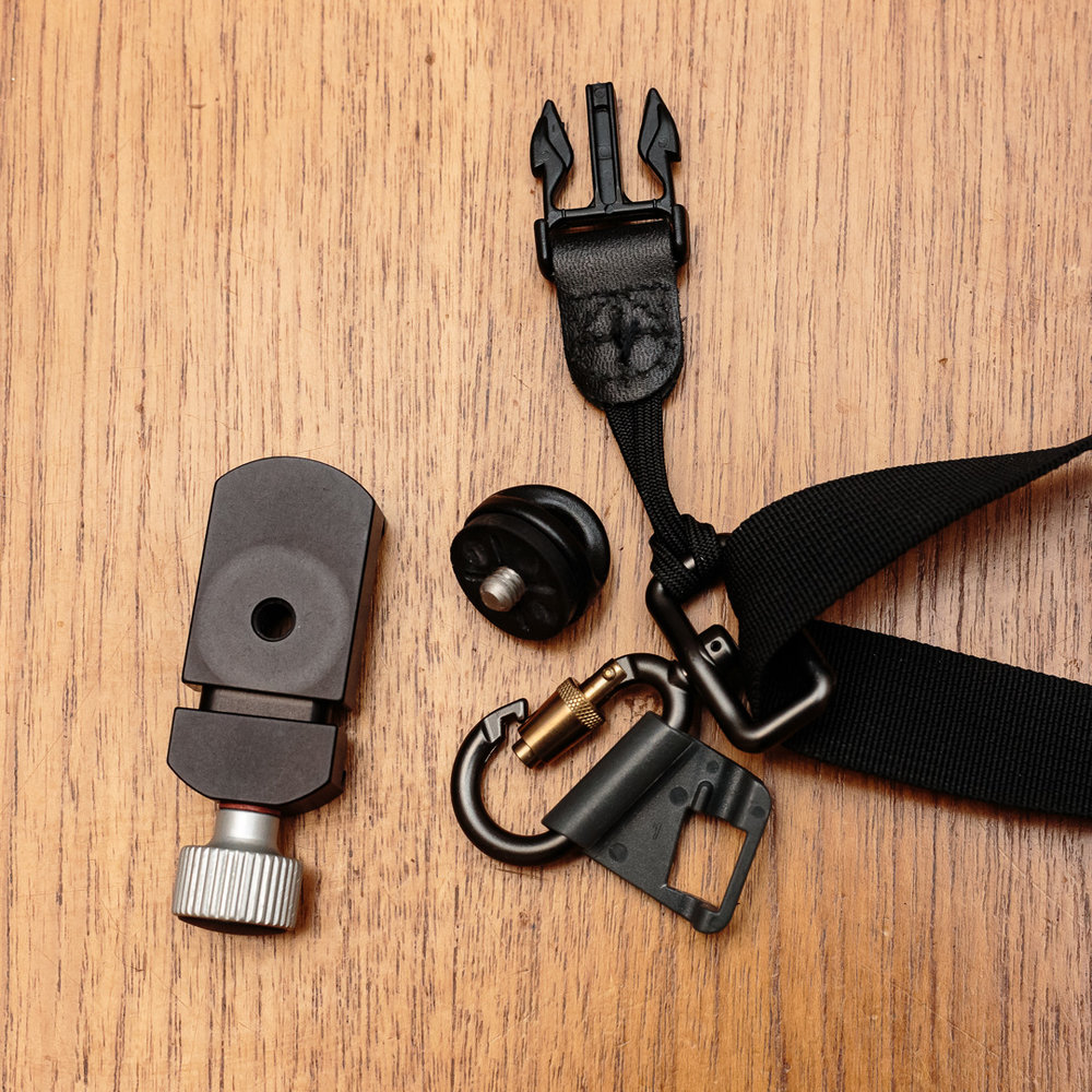 Kirk QRC-1 Quick Release 1 inch Clamp with Black Rapid Sport Breathe strap and fastener.