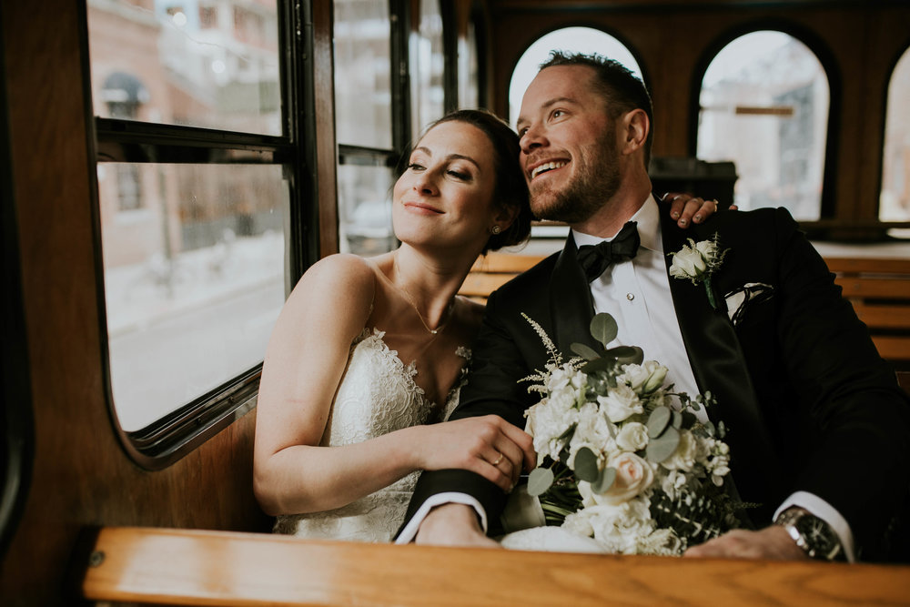 nyc wedding couple on a trolley limo