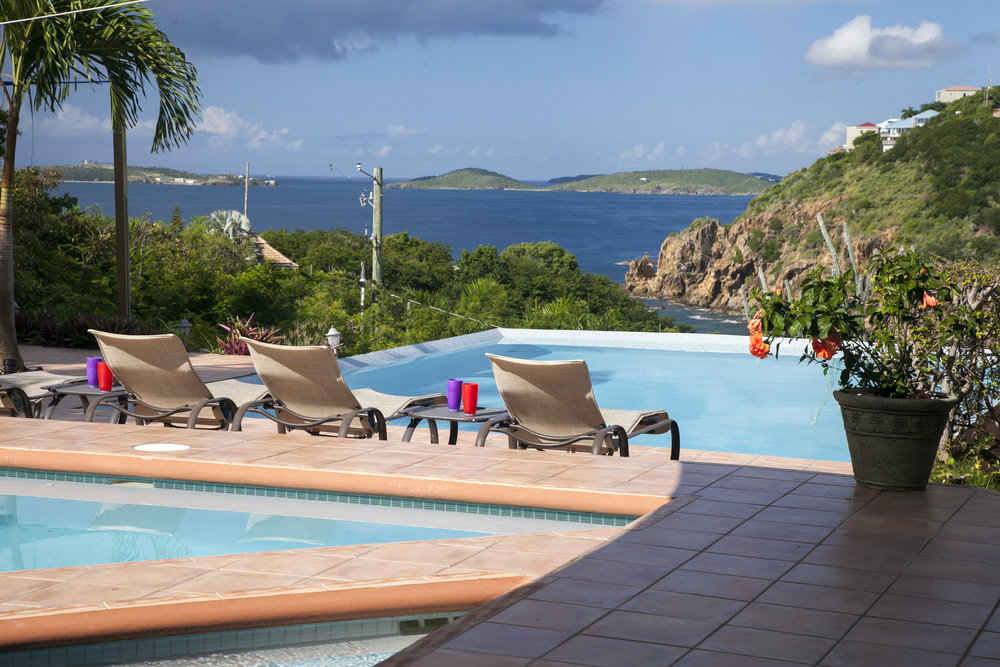 Daytime shot of the big pool and chaise lounges