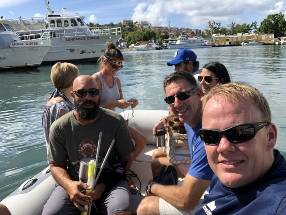 dinghy out to Soulshine catamaran in Cruz Bay