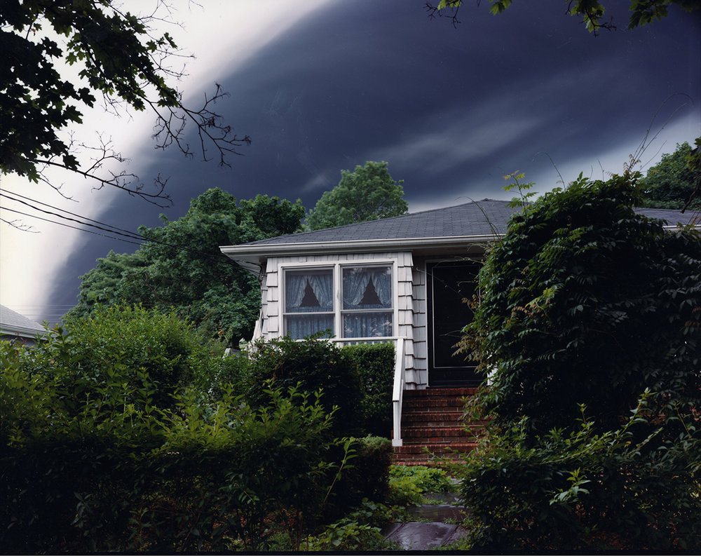 Evacuated house and smoke from three million gallons of gasoline burning in a Shell oil fuel tank struck by lightning, Woodbridge, New Jersey, 1996