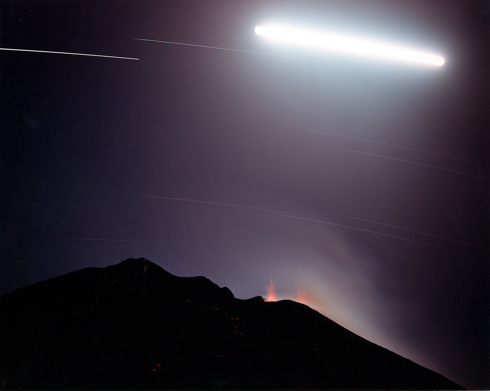 Hikers with flashlights on the slope of erupting volcano, Stromboli, Italy, 1994