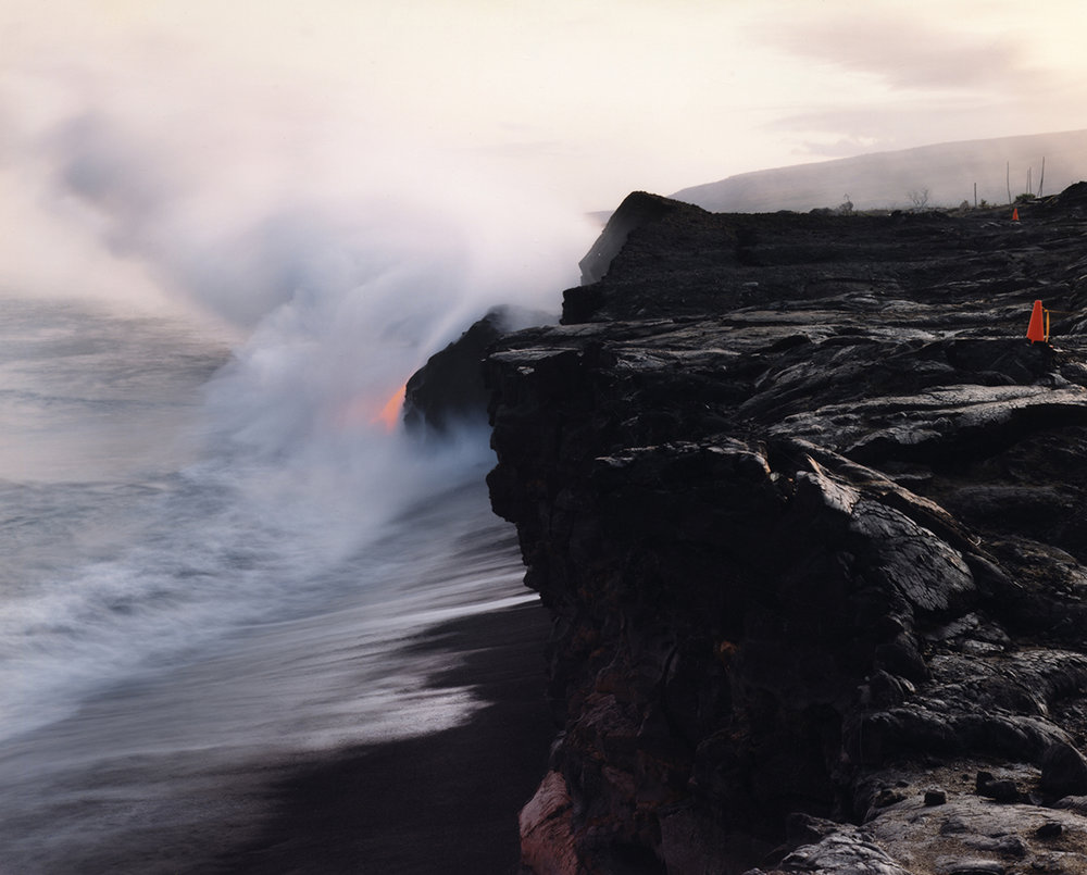 Lava flowing into the sea past remnants of the visitors' center, Volcanoes National Park, Hawai'i, 1991