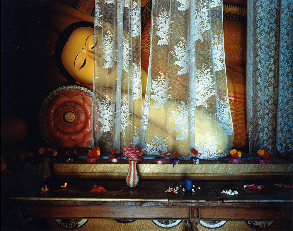 Offerings of jasmine and hibiscus before a sleeping Buddha, Subodhrama Maha Vibaraya Temple, Dehiwala, Sri Lanka, 1993