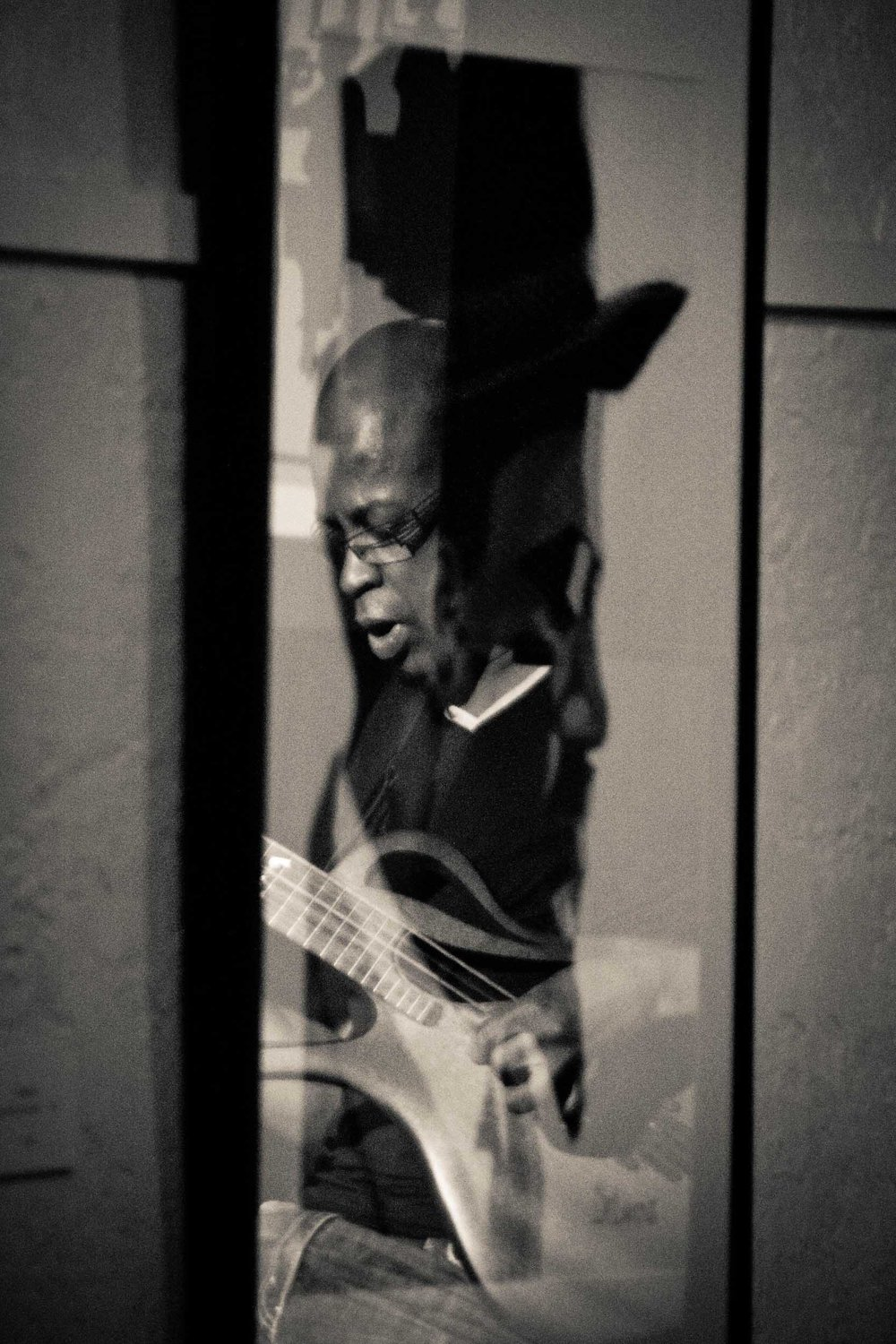 Lionel Loueke at the Jazz Gallery from Unchromed: Jazz NYC - Digital Photograph, 2012, © Jin Zhao