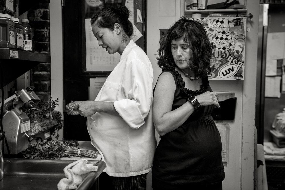TIFFANY, COOK, AND STEPHANIE, RESTAURANT OWNER - 35mm B&W film, 2012, © Carl Bower