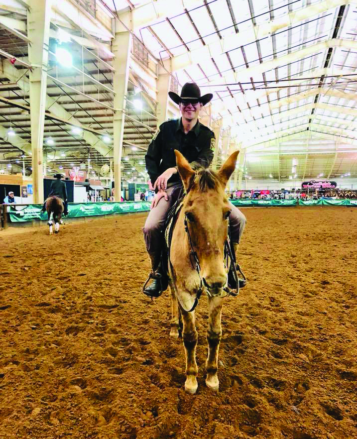 "Trent Harvey and Dun It With A Twist in Freestyle Reining at the NRHA Futurity, set to ""East Bound and Down,"" the theme song from ""Smokey and the Bandit"""