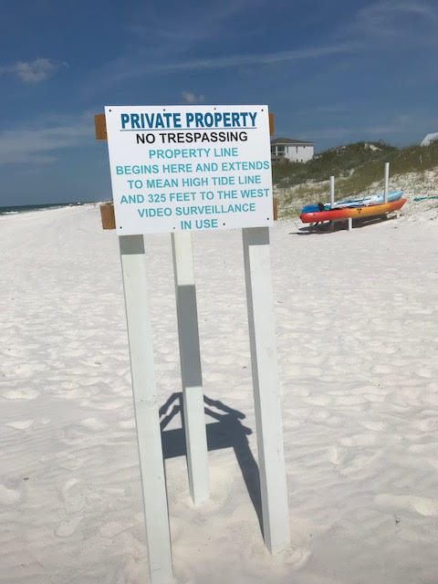 A sign on a South Walton Beach alerts people of private property lines.CREDIT DANIEL UHLFELDER
