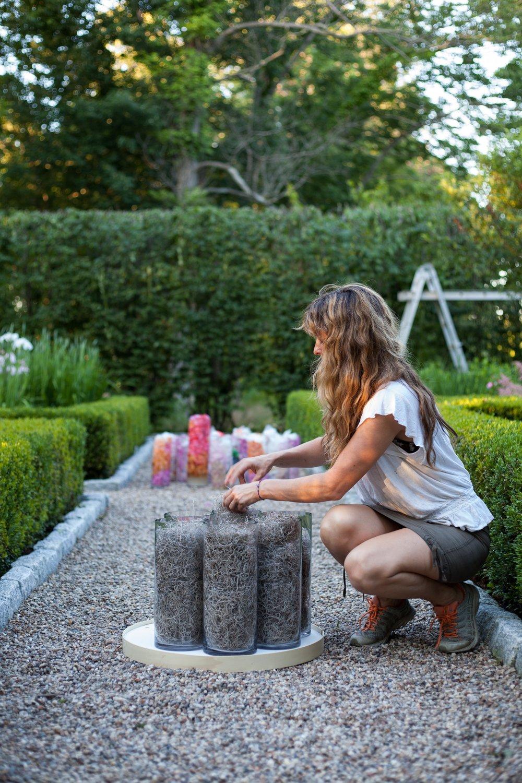 "Stephanie Lindsay preps ""Petal Pillar, Secret Garden."" Photography: Tatiana Rathke."