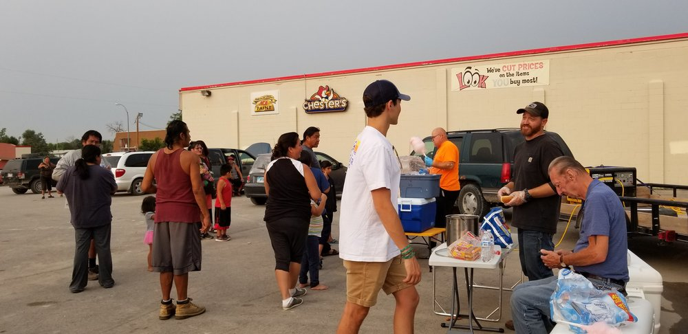 Feeding the people at Sioux Nation grocery store in downtown Pine Ridge on a regular basis