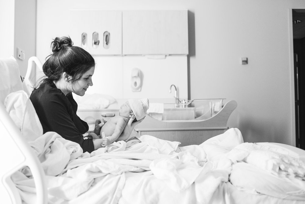 Erin Haapala holds her newborn baby girl Oona Mae Britz on March 10, 2014 at Methodist Hospital in St. Louis Park, MN. Oona was born at 4:44 a.m. at a length of 20 inches, weighing 7 pounds 8 ounces.