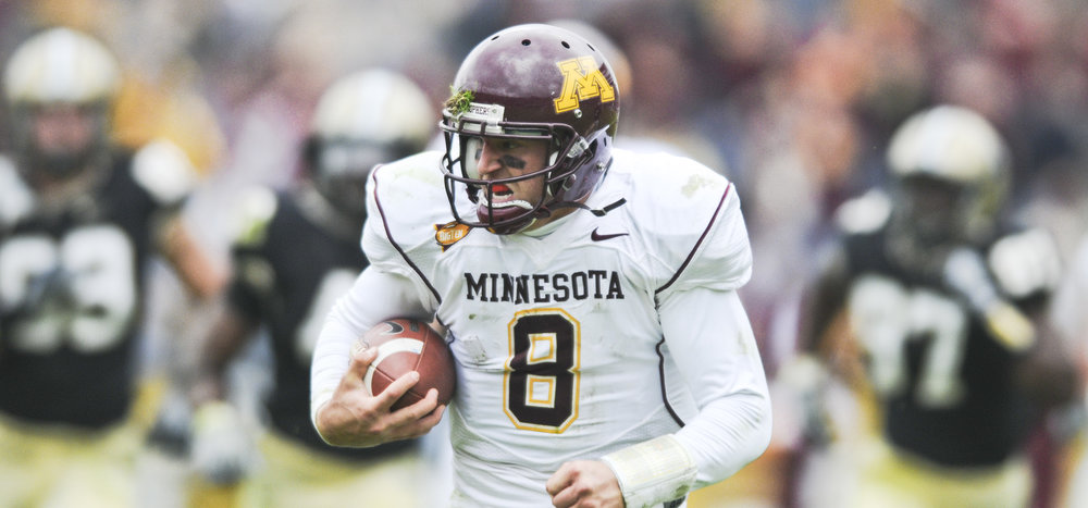 University of Minnesota Golden Gophers quarterback Adam Weber runs the ball within field goal distance during the last half of a game against the Purdue Boilermakers on October 25, 2008 in West Lafayette, Indiana.
