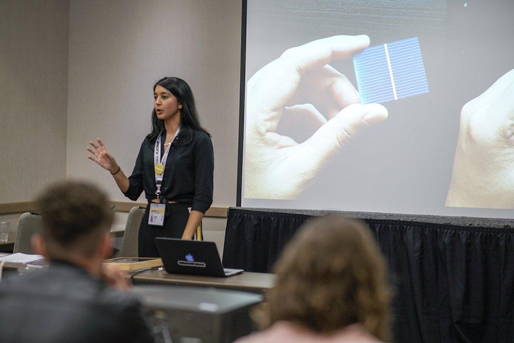 Founder Krystal Persaud explaining different types of solar tech.