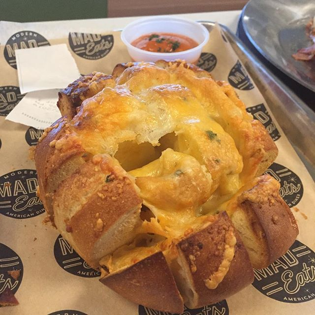 Cheesie garlic pull apart bread. Served with tomato bisque for dipping.