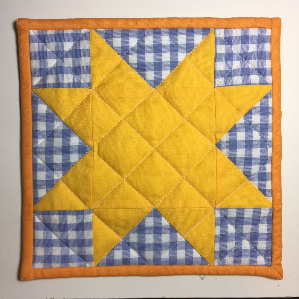 """The """"Virginia Star"""" block, which inspired the quilting design."""