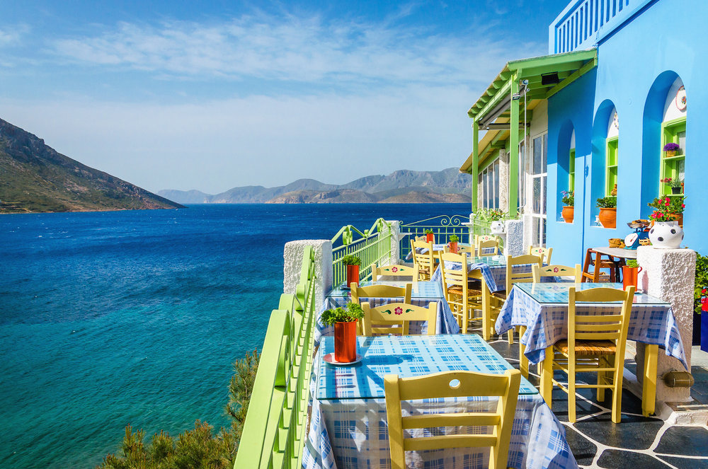 greek-restaurant-on-the-balcony-of-a-blue-building.jpg