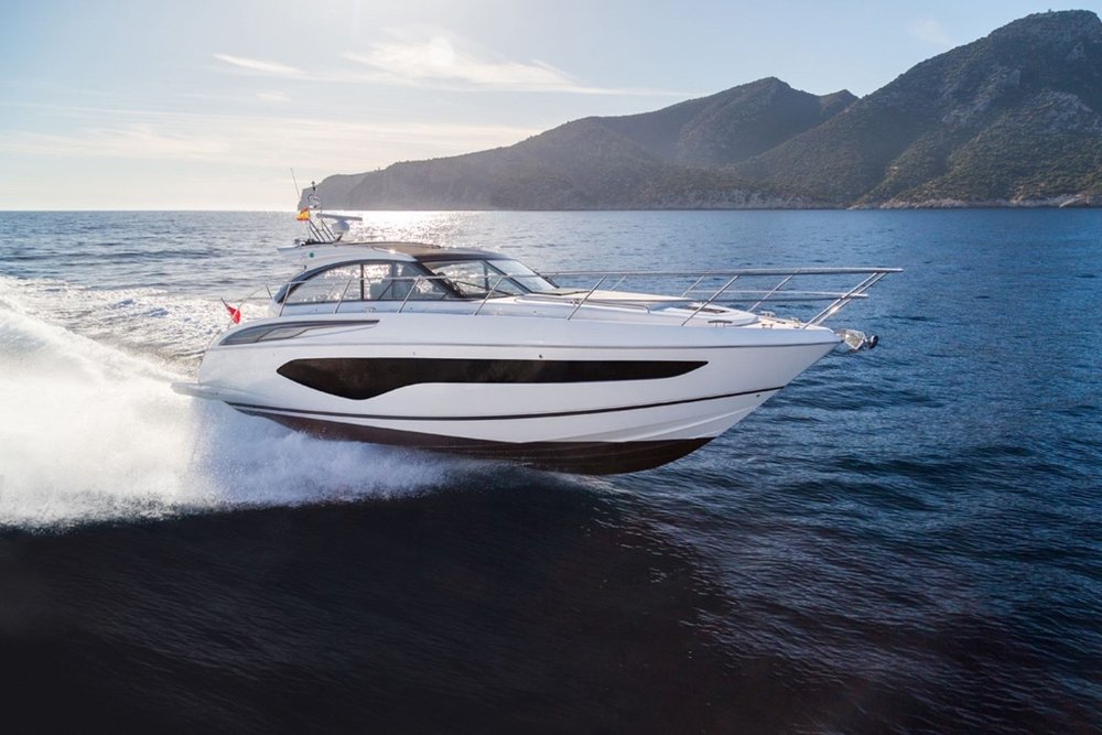 Princess V50 open - The Princess V50 offers versatile cruising that's perfect for life al fresco. With an option for either open or enclosed main deck configuration. this elegant yacht offers style and power in abundance.